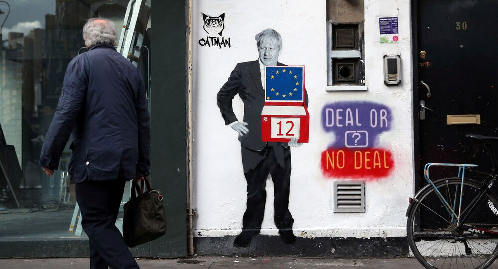A man walks past a mural depicting Britain's Prime Minister Boris Johnson on the side of a residential building in London, Britain, October 15, 2019