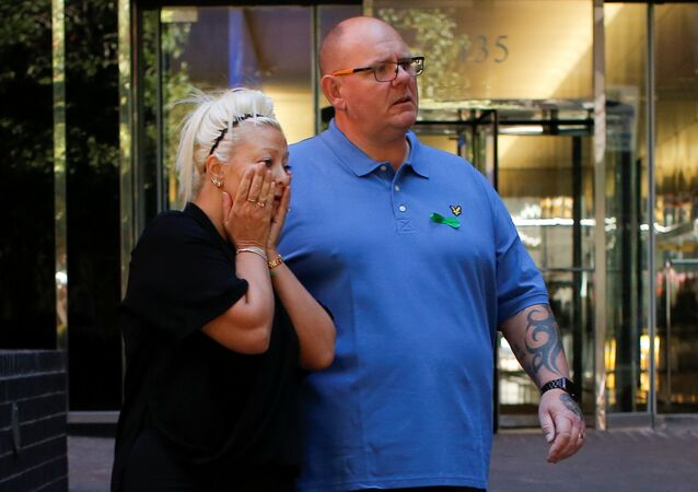 Charlotte Charles and Tim Dunn, parents of British teen Harry Dunn who was killed in a car crash on his motorcycle, allegedly by the wife of an American diplomat, walk out after an interview in the Manhattan borough of New York City, New York, U.S., October 15, 2019