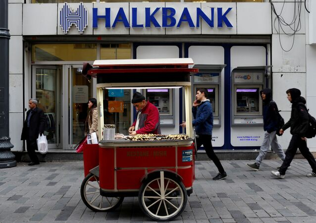 A street vendor sells roasted chestnuts in front of a branch of Halkbank in central Istanbul, Turkey, January 10, 2018