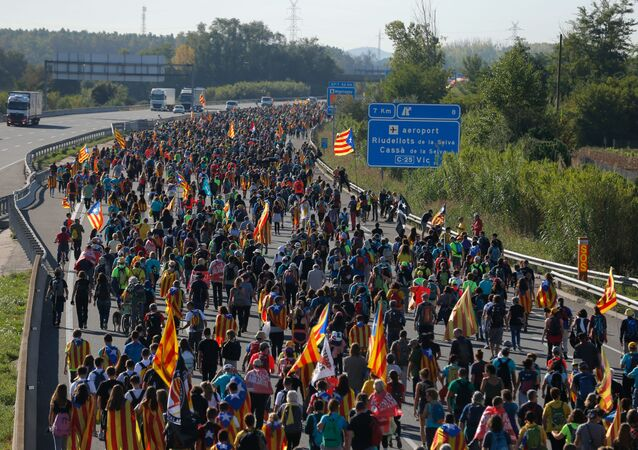 Protesters walk on the AP-7 highway near Girona, on October 16, 2019