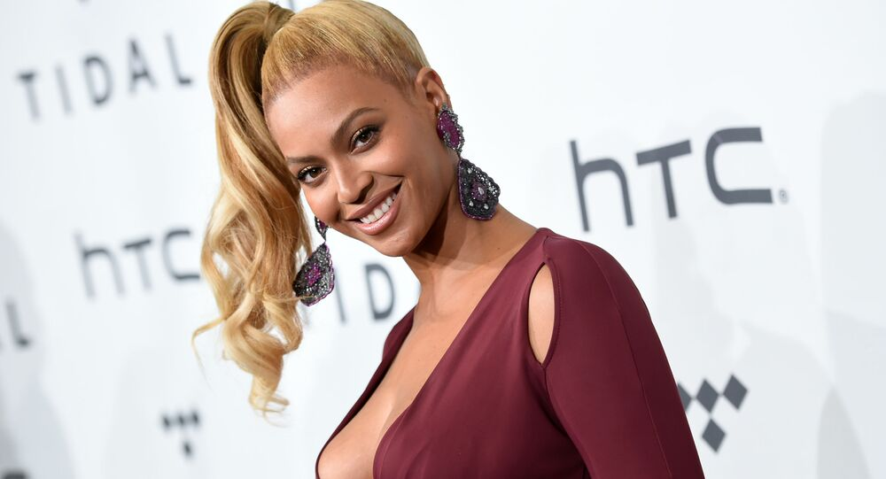 In this Oct. 20, 2015 file photo, singer Beyonce Knowles arrives at TIDAL X: 1020 Amplified by HTC in New York. Beyonce is launching an active wear line for women next month. The singer announced the 2016 spring/summer collection called Ivy Park on Thursday. It's a collaboration with Sir Philip Green and will be available April 14.