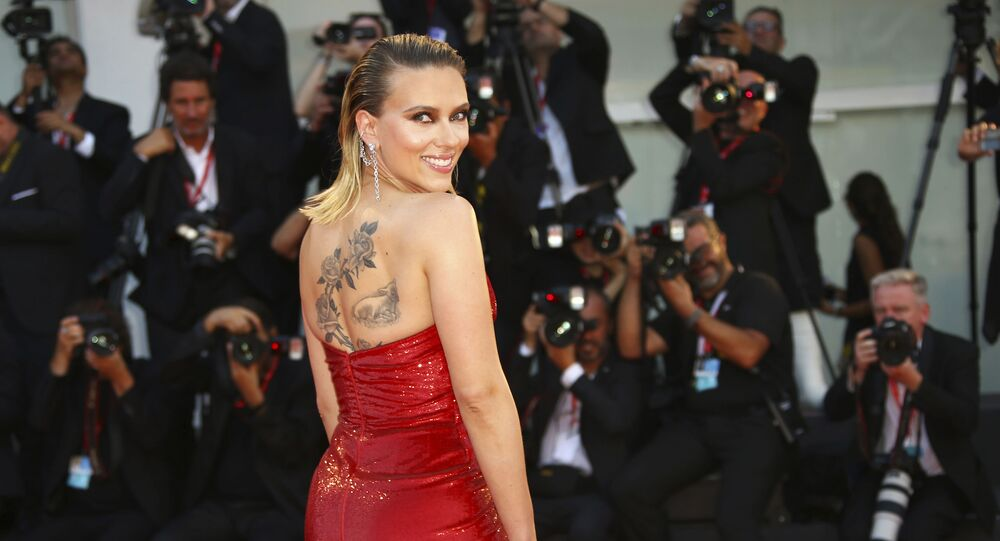 Actress Scarlett Johansson poses for photographers upon arrival at the premiere of the film 'Marriage Story' at the 76th edition of the Venice Film Festival, Venice, Italy, Thursday, Aug. 29, 2019.