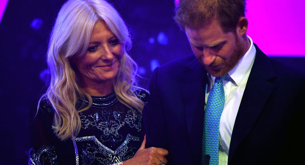 Britain's Prince Harry reacts next to television presenter Gaby Roslin as he delivers a speech during the WellChild Awards Ceremony reception in London, Britain, October 15, 2019