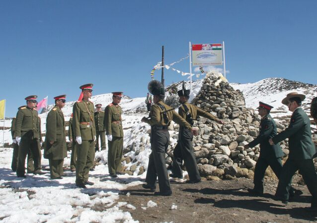 A delegation of the Indian Army, right, marches to meet the delegation of the Chinese army, left, at a Border Personnel Meeting (BPM) on the Chinese side of the Line of Actual Control at Bumla, Indo-China Border, Monday, Oct. 30, 2006