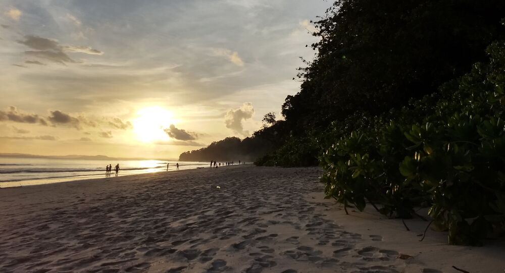 This photograph taken on September 23, 2018 shows sunset on Havelock Island, a tourist haven in the Andaman Islands, a remote Indian archipelago in the Bay of Bengal