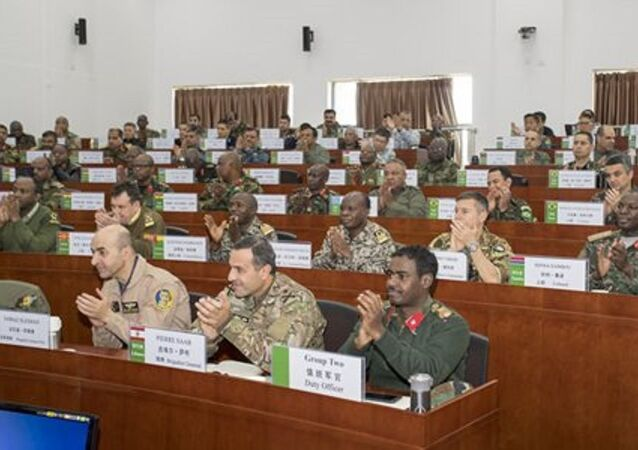 Foreign military officers attend a lecture at the International College of Defense Studies (ICDS) of the National Defense University of the People's Liberation Army