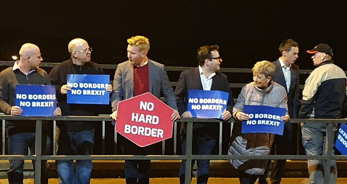 Daniel McCrossan (centre), an SDLP Member of the Northern Ireland Assembly, joins protesters on Lifford Bridge on 16 October 2019