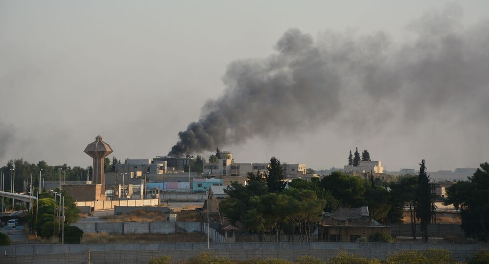 Smoke billows from fires on targets in Syria