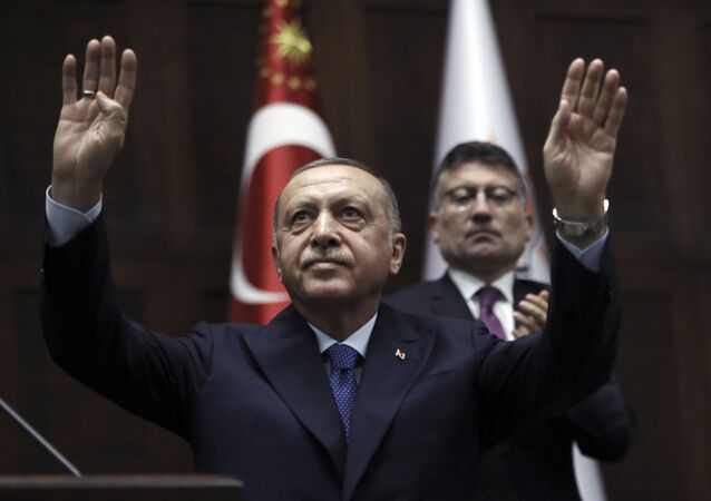 Turkish President Recep Tayyip Erdogan gestures as he addresses his ruling party legislators at the Parliament, in Ankara, Wednesday, Oct 16, 2019.