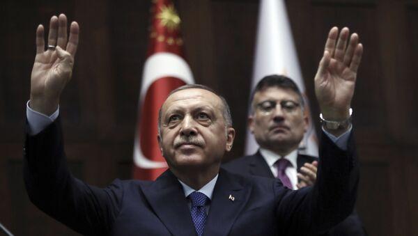 Turkish President Recep Tayyip Erdogan gestures as he addresses his ruling party legislators at the Parliament, in Ankara, Wednesday, Oct 16, 2019. - Sputnik International
