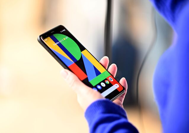 A woman holds tthe Google Pixel 4 phone during a Google product launch event called 'Made by Google 19' in New York City on October 15, 2019