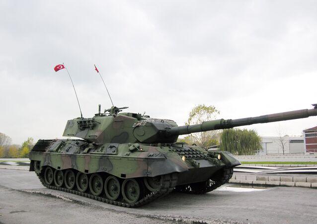 A Turkish army Leopard 1 tank drives through a test range at a military base near the western town of Arifiye, Turkey, Thursday, Nov. 12, 2009