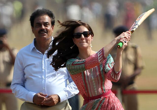 Former Indian cricketer Dilip Vengsarkar looks on as Catherine, Duchess of Cambridge (R) and Britain's Prince William, Duke of Cambridge play a game of cricket with Indian children who are beneficiaries of NGO's at The Oval Maidan in Mumbai on April 10, 2016