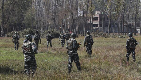 Indian paramilitary soldiers patrol near the site of a gunbattle in Bijbehara, south of Srinagar, Indian controlled Kashmir, Wednesday, Oct. 16, 2019 - Sputnik International