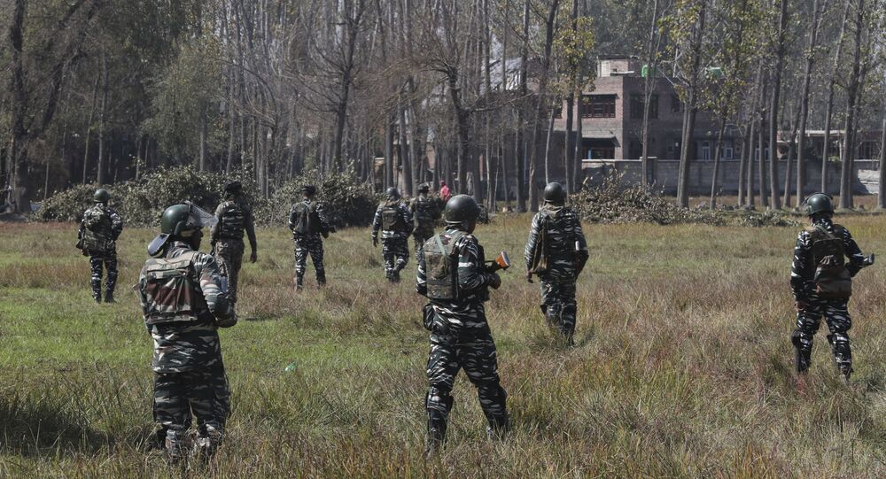 Indian paramilitary soldiers patrol near the site of a gun battle in Bijbehara, south of Srinagar, Indian controlled Kashmir, Wednesday, 16 October 2019