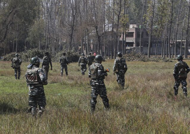 Indian paramilitary soldiers patrol near the site of a gunbattle in Bijbehara, south of Srinagar, Indian controlled Kashmir, Wednesday, Oct. 16, 2019