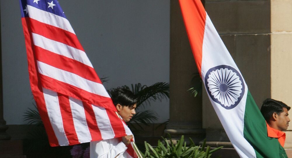 Indian workers carry the U.S. flag, left, and the Indian flag at Hyderabad House, the venue of the talks between U.S. President George W. Bush and Indian Prime Minister Manmohan Singh in New Delhi, India, Thursday, March 2, 2006