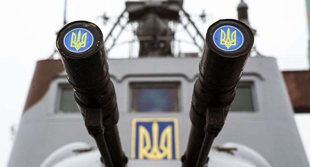 Lids emblazoned with a Ukrainian emblem cover the barrels on a gun mount aboard a Ukrainian coast guard ship (File)