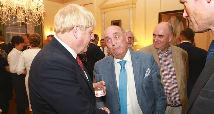 Kieran Kennedy, managing director of O'Neills, chats to Prime Minister Boris Johnson