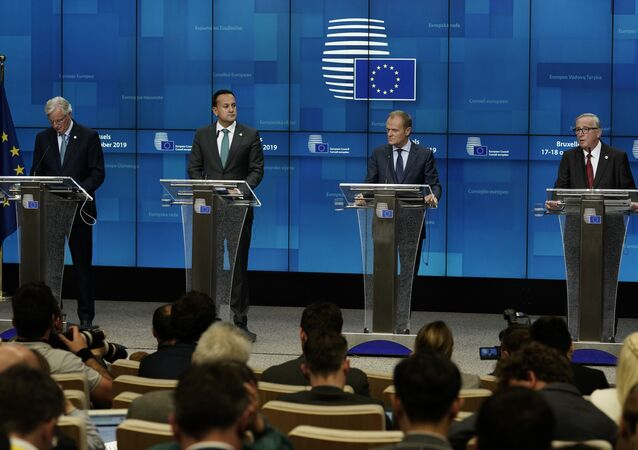 EU chief Brexit negotiator Michel Barnier, Ireland's Prime Minister Leo Varadkar, European Council President Donald Tusk and European Commission President Jean-Claude Juncker address a press conference during an European Union Summit at European Union Headquarters in Brussels on October 17, 2019.