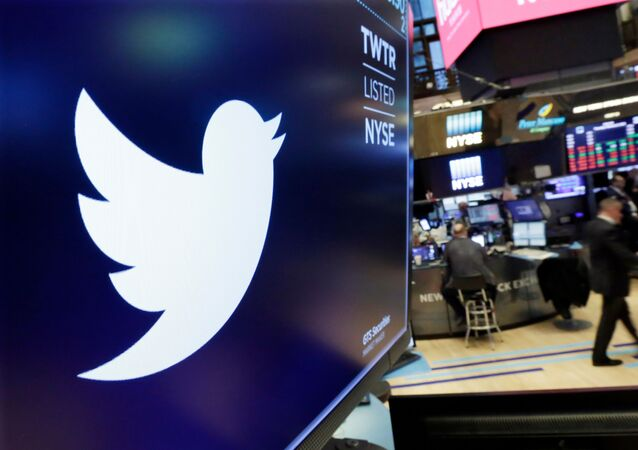 FILE - In this Feb. 8, 2018, file photo, the logo for Twitter is displayed above a trading post on the floor of the New York Stock Exchange
