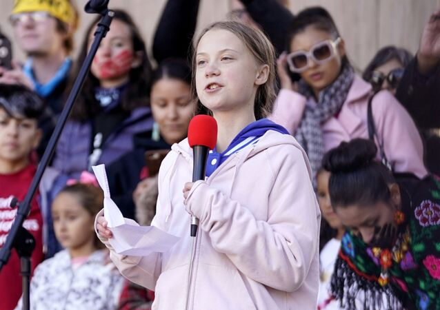 Swedish teen environmental activist Greta Thunberg speaks as people take part in a climate change rally in Denver, Colorado, U.S. October 11, 2019