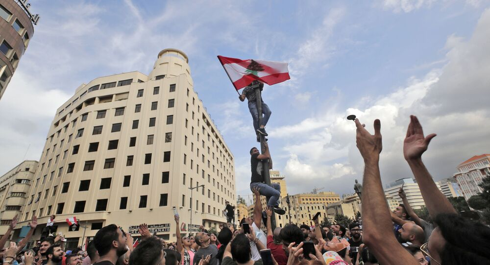 Lebanese demonstrators gather during a mass protest in the centre of the capital Beirut on October 18, 2019
