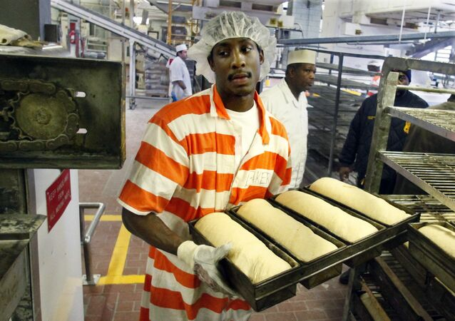 Inmate Nikos Alexis loads fresh dough into an oven at the Rikers Island jail bakery in New York in 2011.