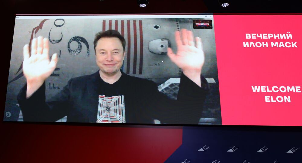 Elon Musk gestures as he speaks on a live Skype conference call at the annual business conference Delo za malym in Krasnodar, Russia on Friday, 18 October.