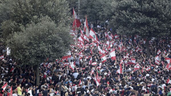 Anti-government protesters shout slogans against the Lebanese government during a protest in Beirut, Lebanon, Saturday, Oct. 19, 2019. - Sputnik International
