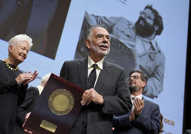 US director Francis Ford Coppola holds his award during the Lumiere Award ceremony of the 11th Lumiere Festival, in Lyon, central France, Friday, Oct. 18, 2019.