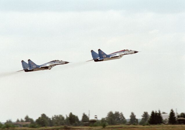 MiG-25 warplanes take off during a parade rehearsal