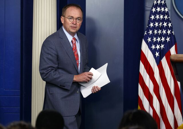 FILE - In this Thursday, Oct. 17, 2019, file photo, White House chief of staff Mick Mulvaney arrives to a news conference, in Washington