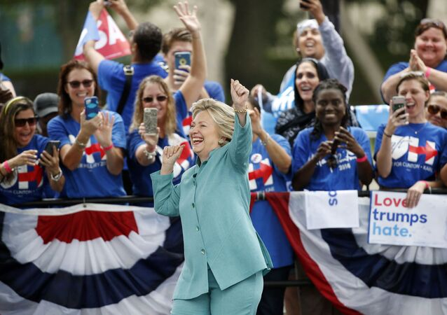 Democratic presidential candidate Hillary Clinton dances as she is introduced at a rally, 5 November 2016, in Pembroke Pines, Florida.