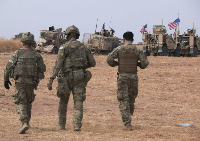 American military convoy stops near the town of Tel Tamr, north Syria, Sunday, Oct. 20, 2019