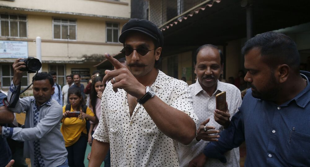 Bollywood actor Ranveer Singh shows indelible ink mark on his index finger after casting his vote outside a polling station in Mumbai, Monday, Oct. 21, 2019