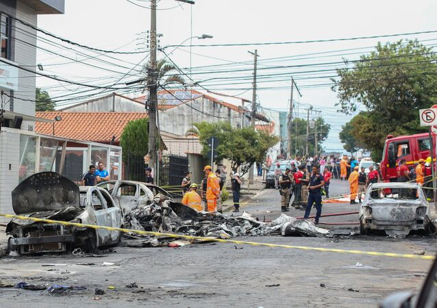 Wrecked cars are seen at the site where a small plane crashed on a residential street in Belo Horizonte, Brazil October 21, 2019