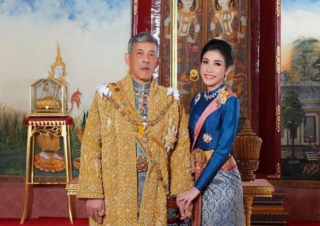 King Maha Vajiralongkorn, left, with Major General Sineenatra Wongvajirabhakdi, the royal noble consort