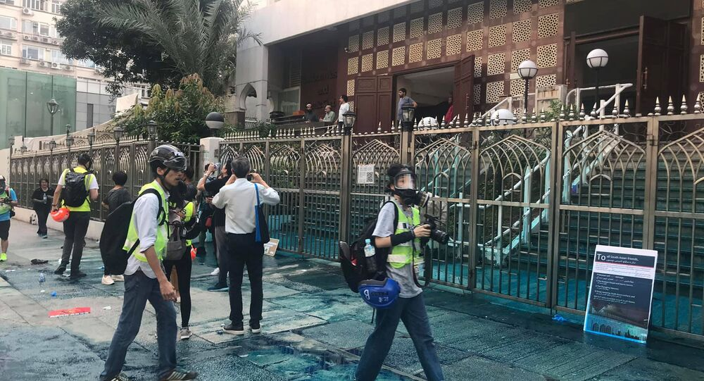 Members of the press are seen outside the Kowloon Masjid and Islamic Centre in Hong Kong, China, after police doused it with a water cannon, on October 20, 2019 in this picture obtained from social media