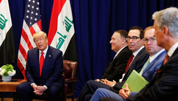 U.S. President Donald Trump speaks next to members of the U.S. delegation -- U.S. Secretary of State Mike Pompeo; Treasury Secretary Steve Mnuchin, Acting White House Chief of Staff Mick Mulvaney and National Security Advisor Robert O'Brien, during a bilateral meeting with Iraq's President Barham Salih on the sidelines of the annual United Nations General Assembly in New York City, New York, U.S., September 24, 2019 - Sputnik International