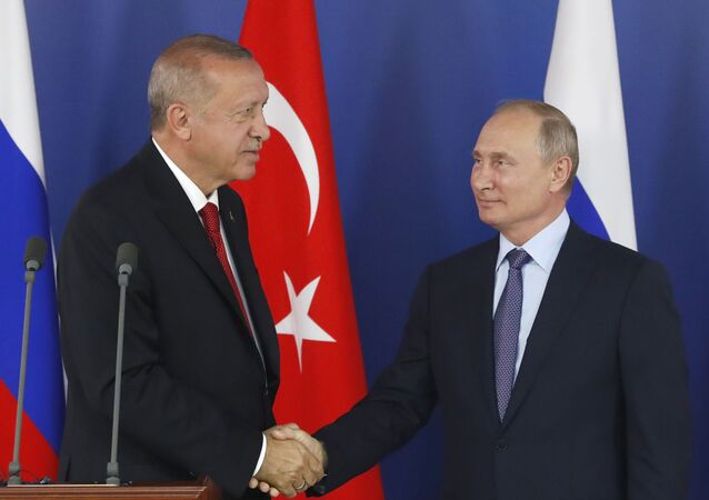 Turkish President Recep Tayyip Erdogan, left, shakes hands with Russian President Vladimir Putin during a joint news conference following their talks on the sidelines of the MAKS-2019 International Aviation and Space Show in Zhukovsky, outside Moscow, Russia, on 27 August 2019.