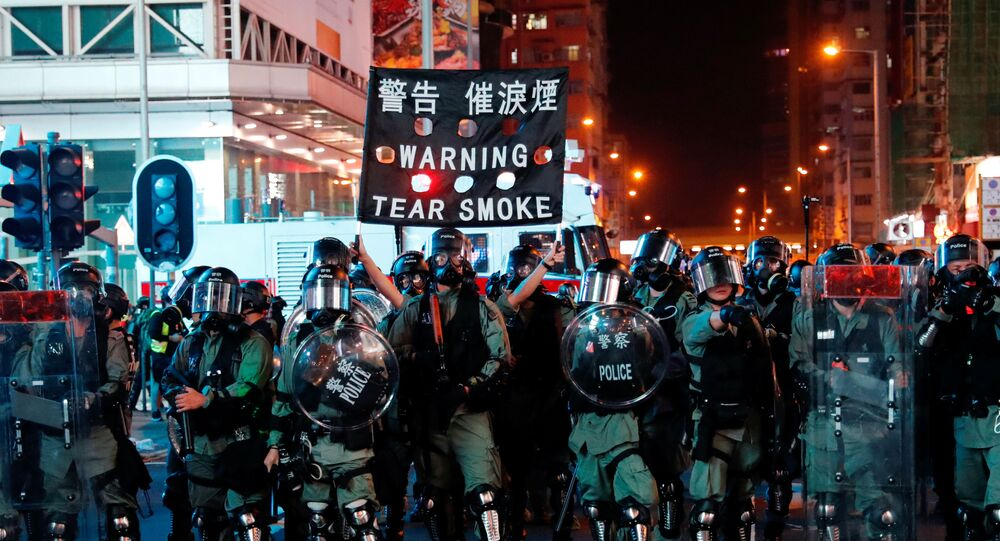 Riot police hold up a banner warning protesters about tear gas during anti-government protest in Hong Kong, China October 20, 2019
