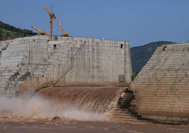 Water flows through Ethiopia's Grand Renaissance Dam as it undergoes construction work on the river Nile in Guba Woreda, Benishangul Gumuz Region, Ethiopia September 26, 2019