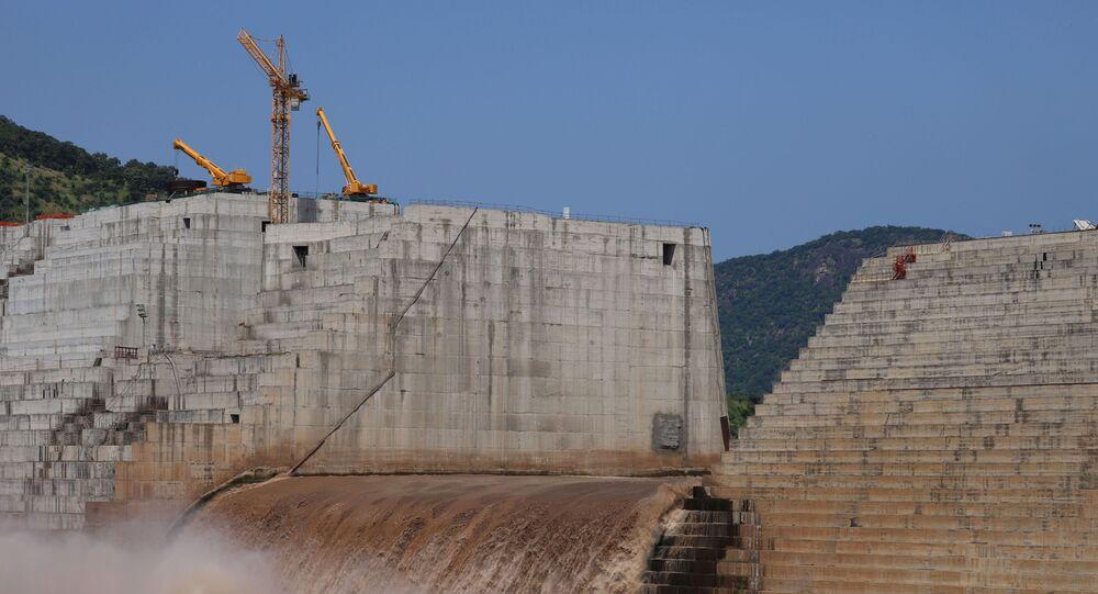Water flows through Ethiopia's Grand Renaissance Dam as it undergoes construction work on the river Nile in Guba Woreda, Benishangul Gumuz Region, Ethiopia September 26, 2019