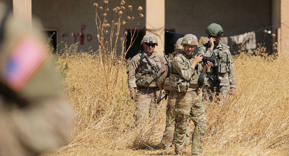 Turkish and American soldiers stand near a former YPG military point during a joint U.S.-Turkey patrol, near Tel Abyad, Syria September 8, 2019