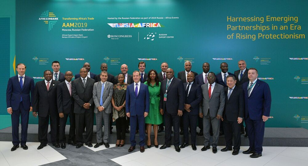 Russian Prime Minister Dmitry Medvedev poses for a family photo before the economic conference titled Russia-Africa as part of the annual meeting of The African Export-Import Bank's shareholders in Moscow, Russia