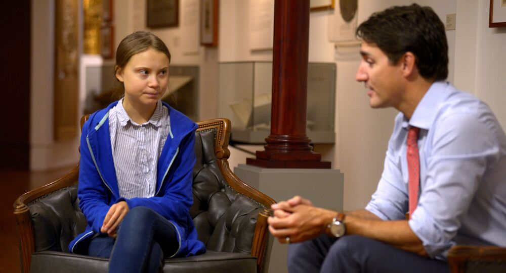Canada's Prime Minister Justin Trudeau greets Swedish climate change teen activist Greta Thunberg before a climate strike march in Montreal, Quebec, Canada September 27, 2019