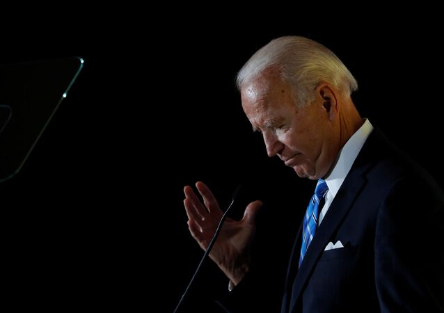 Democratic presidential candidate former Vice President Joe Biden reacts as he delivers a speech during the Women's Leadership Forum in Washington, U.S. October 17, 2019