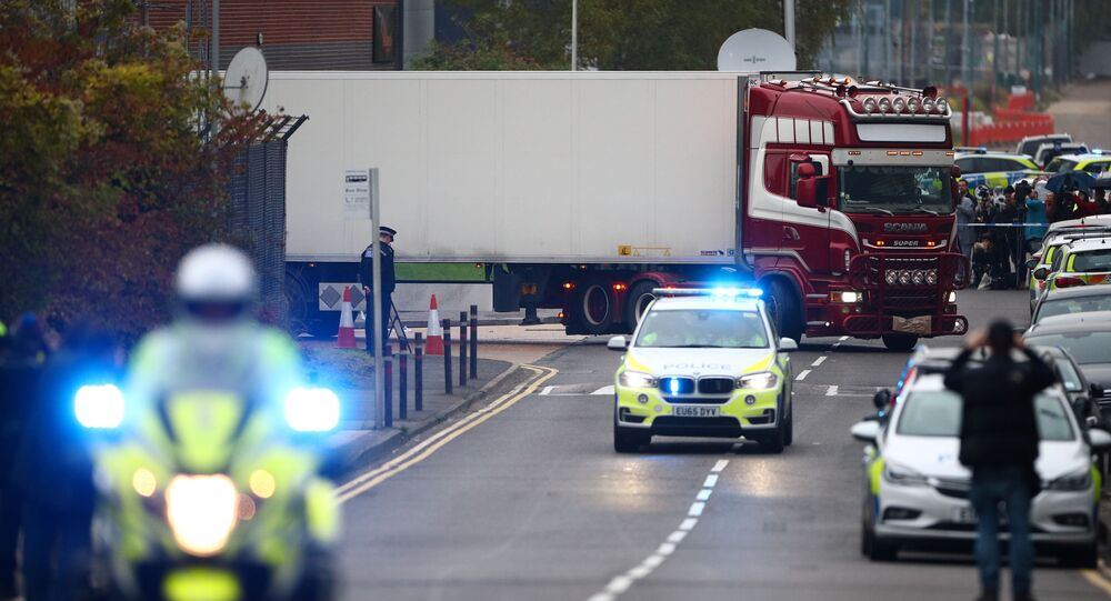 Police move the lorry container where bodies were discovered, in Grays, Essex, Britain 23 October 2019