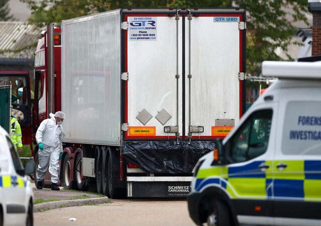 Police are seen at the scene where bodies were discovered in a lorry container, in Grays, Essex, Britain October 23, 2019